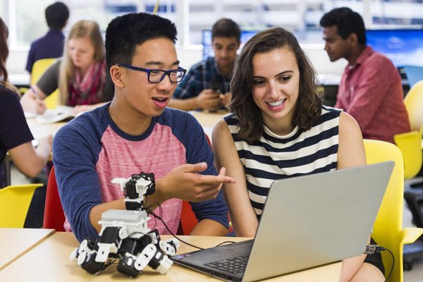 Students working with a robot