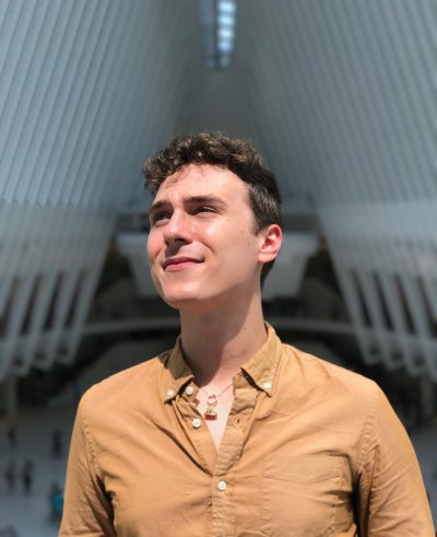 Joshua Soucie, an arts reporter, stands inside New York City's famous Oculus.