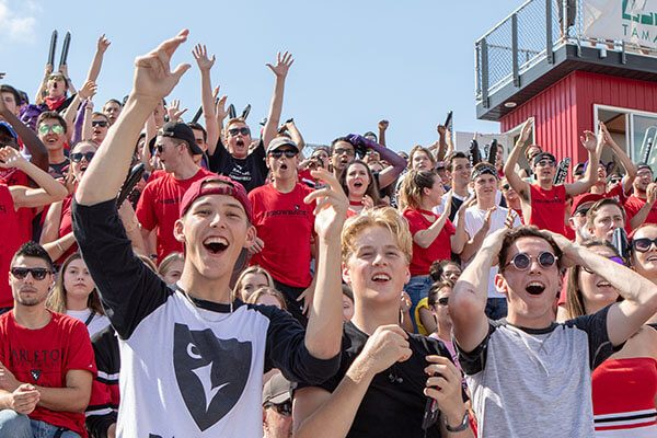Fans cheer for the Raven's football team.