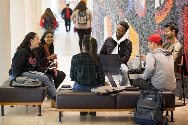 Students sitting in the Tory Building lobby.