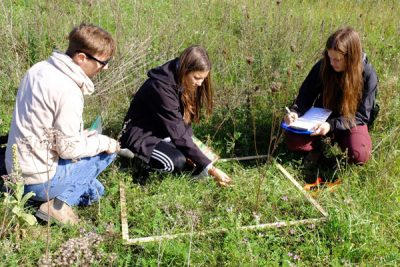 Environmental Science students take notes outside.