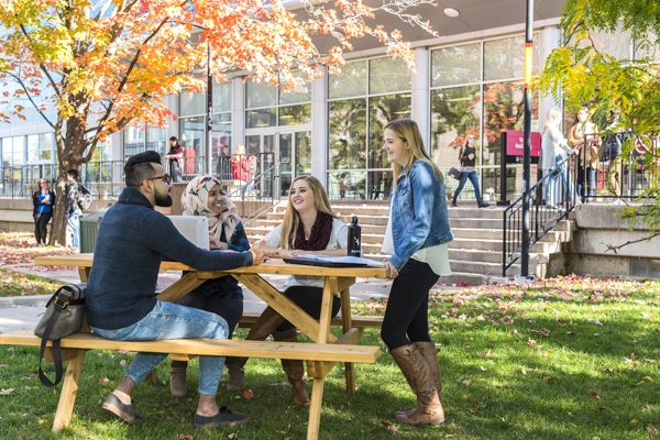 Carleton students outside in the academic quad.