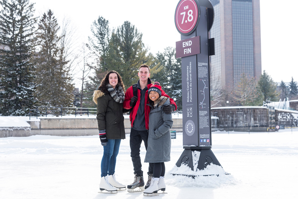 Carleton University students skate on the Rideau Canal near campus.